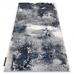 Moderný koberec DE LUXE 528 Abstrakcia - Štrukturálny krém / tmavomodrý