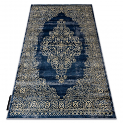 Moderný koberec DE LUXE 474 ornament - Štrukturálny tmavomodrý / zlato
